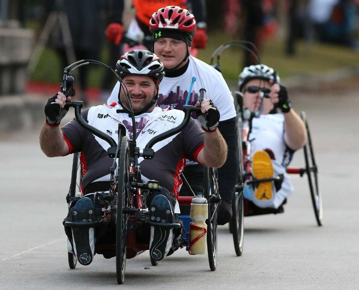 Handcycle wheelchair racers compete in their first Chevron Houston Marathon in Houston, Texas on Sunday, January 18, 2015. To view or purchase this photo and others like it, go to HCNPics.com.