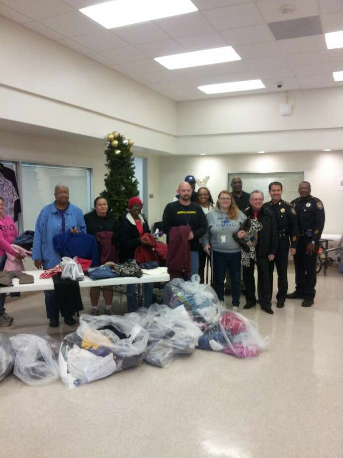 """Deputy Keith Royston(far right) and HSCO deputies and Sheriff Adrian Garcia brought donations they received for the 2nd annual """"Soles For You"""" Boot Drive to the Star of Hope shelter in Houston in December of last year."""