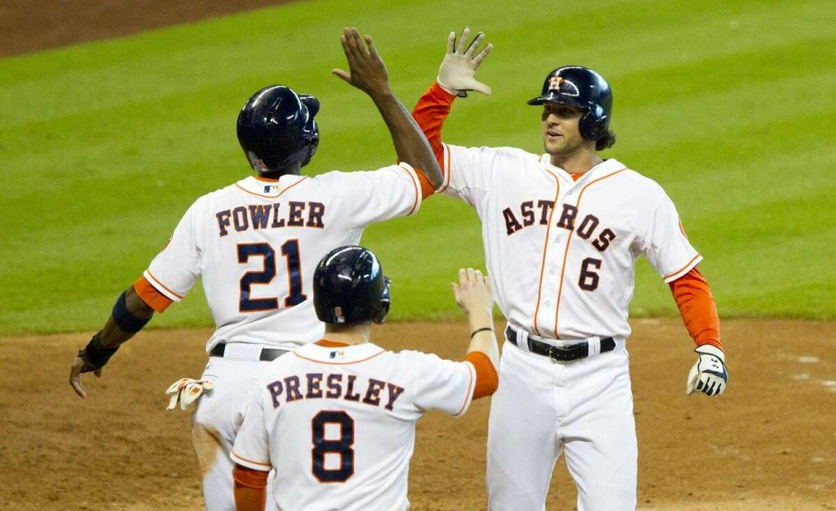 The Astros' Jake Marisnick, right, celebrates with Dexter Fowler and Alex Presley after hitting a three-run home run in the seventh inning against Seattle. The Astros won 8-3.