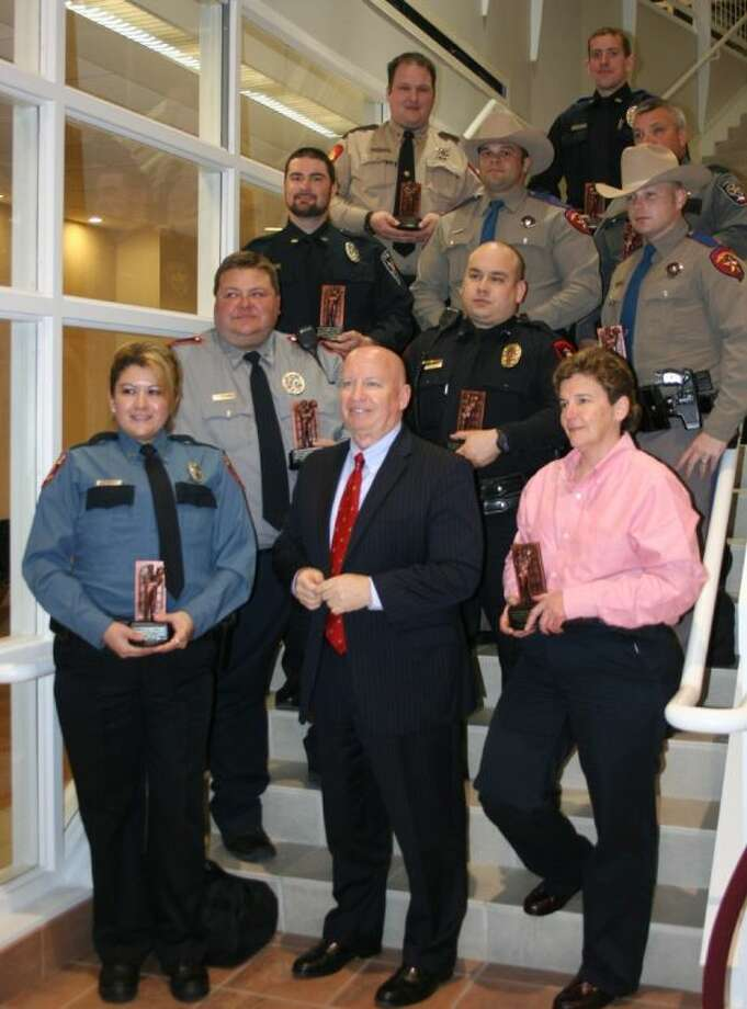 Congressman Kevin Brady took time out to pose with the Montgomery County officers of the year during the annual Law Enforcement Appreciation Dinner on Feb. 24. Photo: STEPHANIE BUCKNER