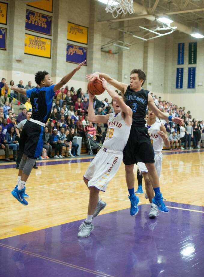 Episcopal senior Peter Nyberg rises up to get a hand on a Kinkaid shot during the Knights' huge 56-51 win over the Falcons Friday night to remain in first place in their Southwest Preparatory Conference South Zone. The Knights went to 2-0 with the victory while Kinkaid fell to 1-2 in the South Zone with the loss. Photo: Kevin B Long