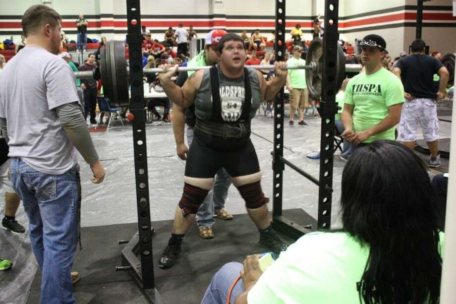 A Coldspring-Oakhurst powerlifter displays his strength by squatting over 450 lbs. Photo: JACOB MCADAMS