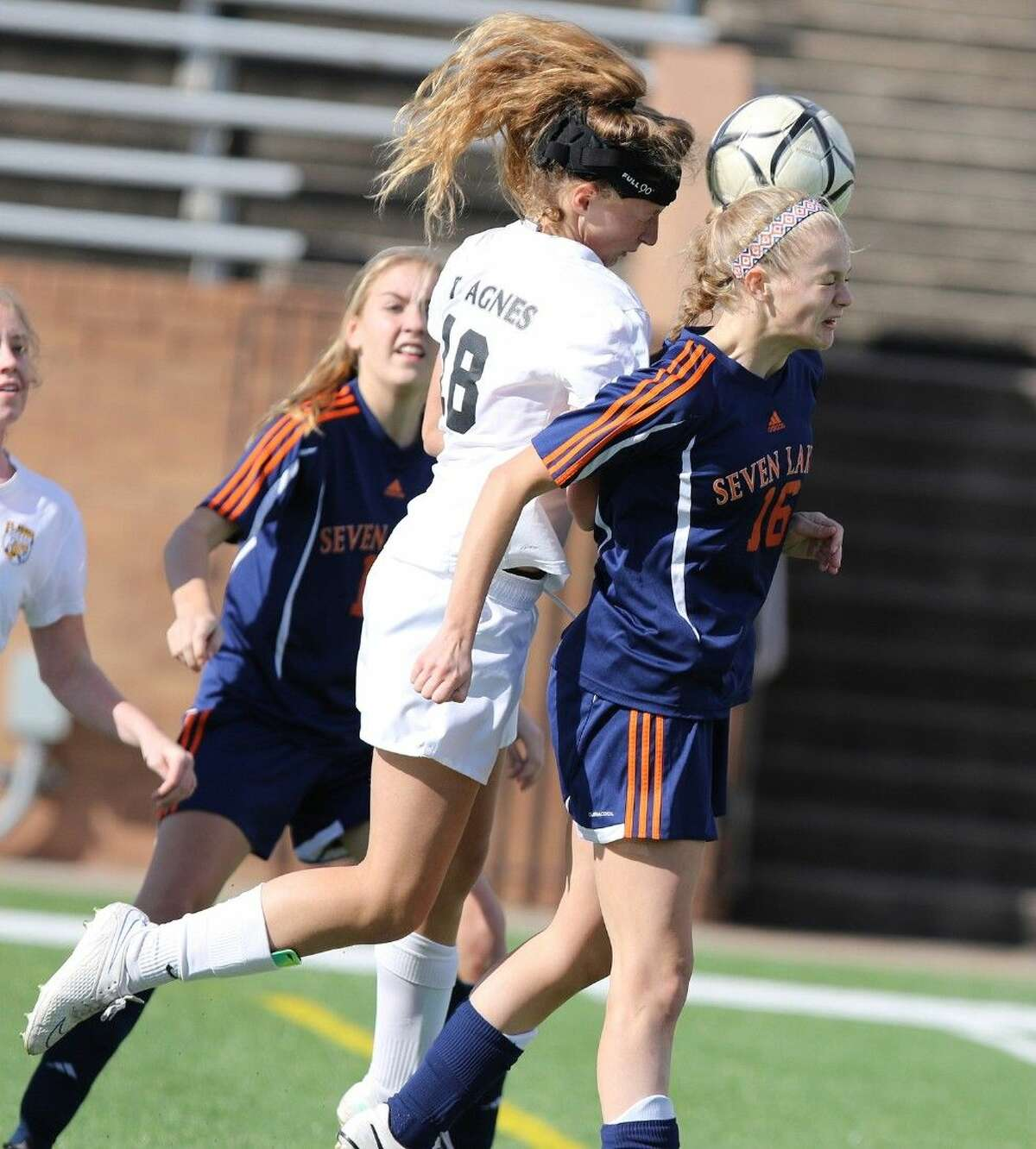 St. Agnes' Elyse Hanse and Seven Lakes' Morgan Proffitt go for a header during the Katy I-10 Shootout, Spartan Bracket Final on Jan. 17 in Katy. To view or purchase this photo and others like it, go to HCNPics.com.