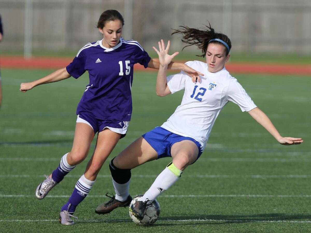 Fort Bend Ridge Point's Courtney Pawlik and Katy Taylor's Mary Heiberger go for control of the ball during their Jan. 16 game in the Katy I-10 Shootout at Taylor High School in Katy. To view or purchase this photo and others like it, go to HCNPics.com.
