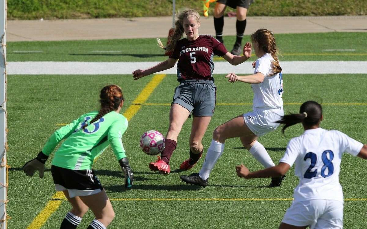Cinco Ranch's Taryn Siegele drives on the goal against Clear Springs' Lexie Leblanc during the Katy I-10 Shootout, Cougar Bracket Final on Jan. 17 in Katy. To view or purchase this photo and others like it, go to HCNPics.com.