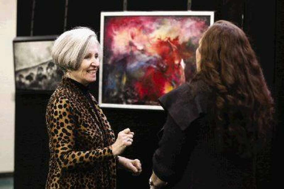Anatomy and physiology teacher Martha Mitchell, left, speaks with Art Trust volunteer Carol Durkee during The 100 Friends of Art Luncheon on Friday at The Woodlands High School.