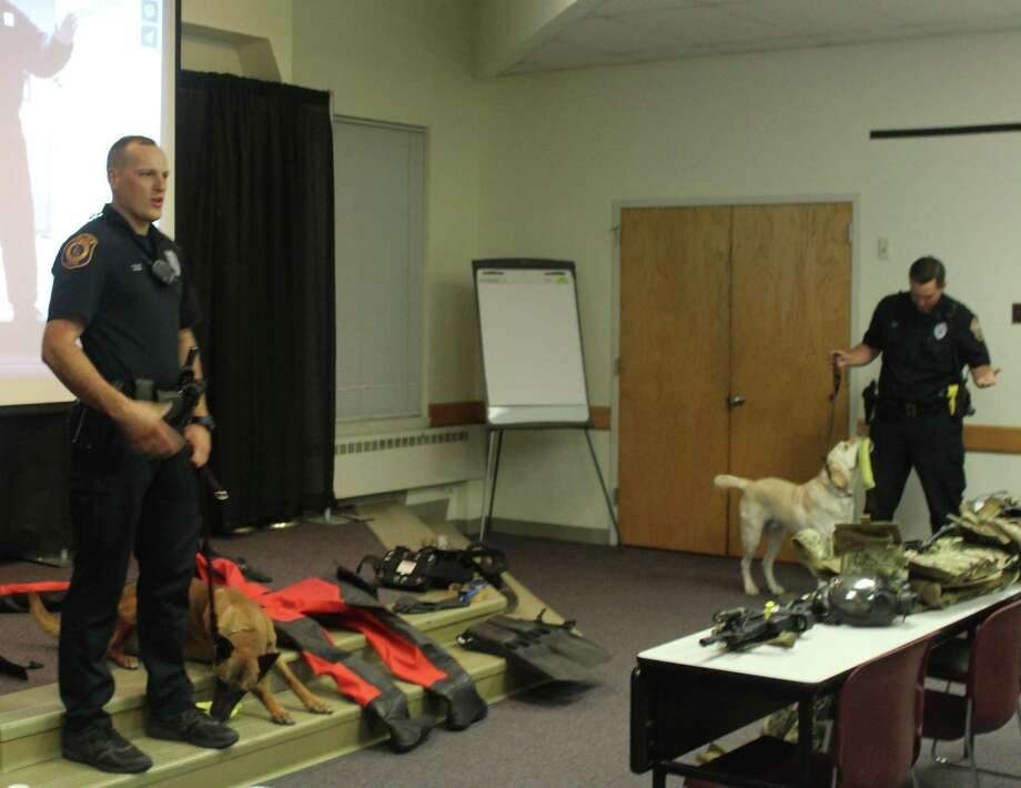 Officer James Loomer (left), accompanied by police dog Koda, and Officer James Baker, with police dog Chase, present on the department's K-9 unit during the third week of the citizens' police academy in Westport, Conn. on Sept. 22, 2016. Photo: Laura Weiss / Hearst Connecticut Media / Westport News