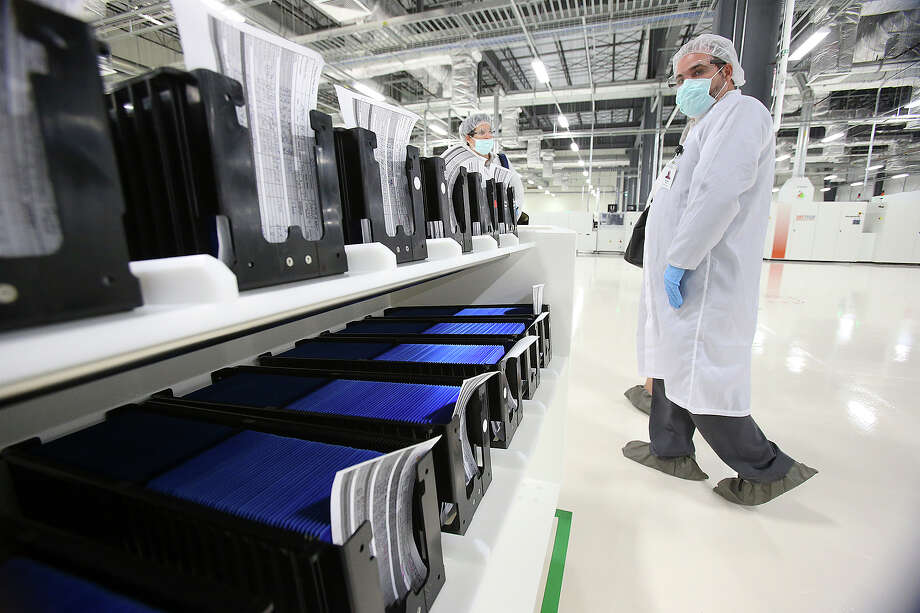 File photo of the production line at Mission Solar's Brooks City Base location in San Antonio. The local solar panel maker is laying off 87 employees as it outsources solar cell manufacturing to a supplier in Asia. Photo: TOM REEL /San Antonio Express-News / San Antonio Express-News