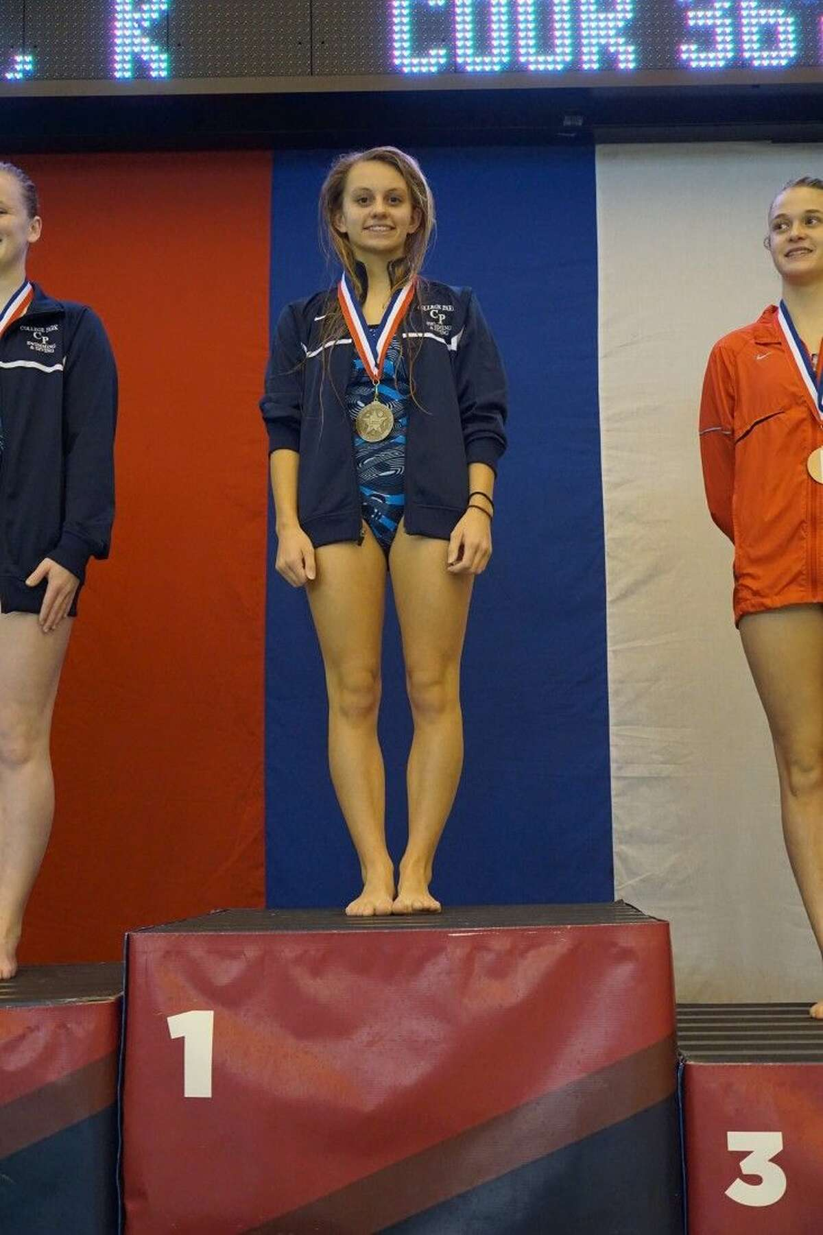 College Park's Emma Dellmore finished first in the girls 1-meter diving competition.