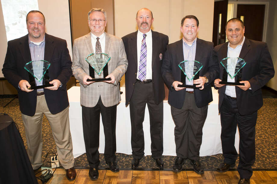 FROM LEFT: Chris Sizemore, Norman Funderburk, Humble High School baseball head coach David Sitton, Craig Shirley and Chris Almendarez pose with their Hall of Fame induction trophies at the Humble Baseball Hall of Fame Banquet on Jan. 24, 2015, at Walden Country Club. Photo: ANDREW BUCKLEY