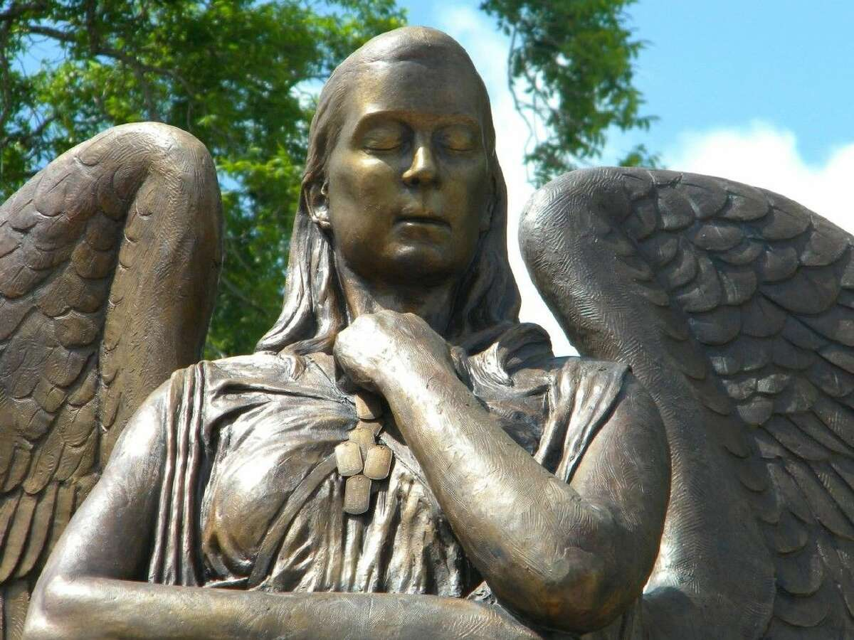 A close-up view of the 17-foot tall angel in Smithville, Texas, created by Bill McGlaun, shows McGlaun's ability for capturing emotions on the faces of his sculptures.