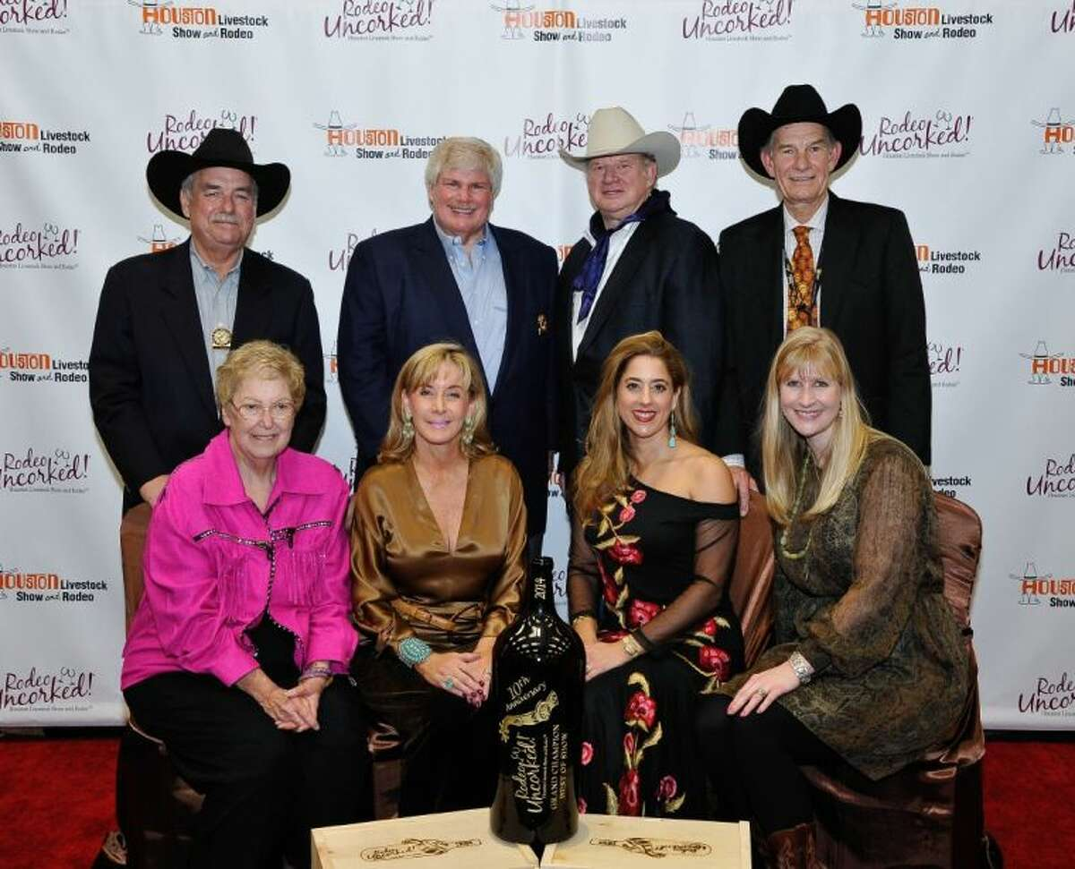 The buyers for the Grand Champion Wine at the 10th Annual Wine Dinner and Charity auction set a record bid of $230,000 for a magnum of wine which benefits charity functions of the Houston Livestock Show and Rodeo.