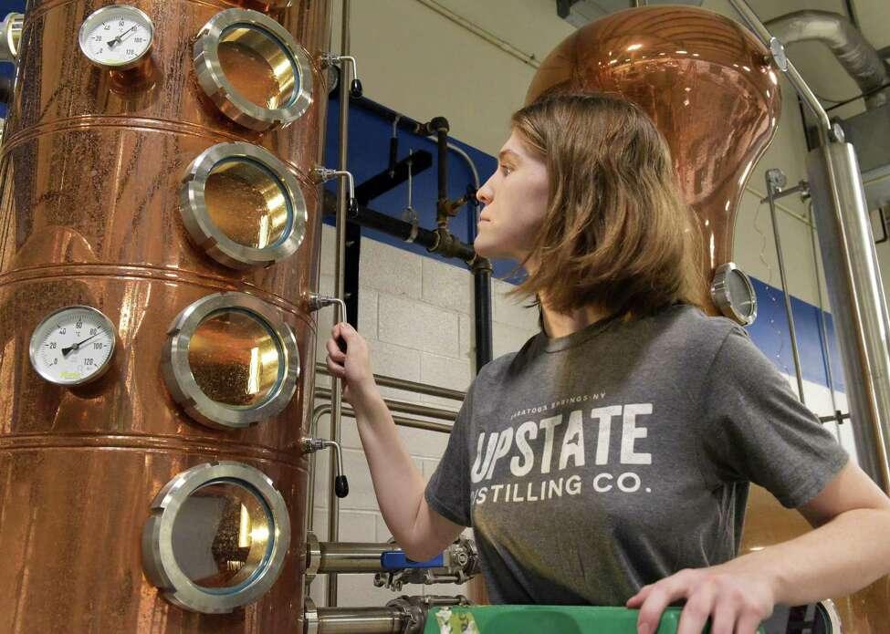 Distiller Glenna Joyce checks the column still at Upstate Distilling Company Friday Sept. 23, 2016 in Saratoga Springs, NY. (John Carl D'Annibale / Times Union)