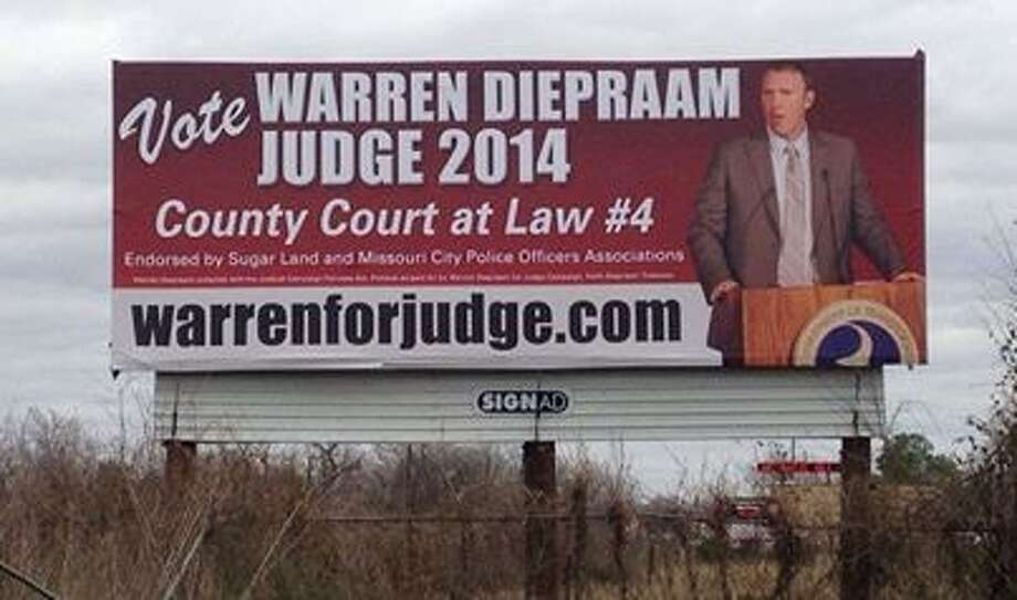 """One of Montgomery County deputy prosecutor Warren Diepraam's billboards is seen in Fort Bend County following his unsuccessful campaign to unseat incumbent Fort Bend County Judge R. H. """"Sandy"""" Bielstein. Diepraam lost Tuesday night and will return full-time to his many duties as a special Montgomery County prosecutor."""