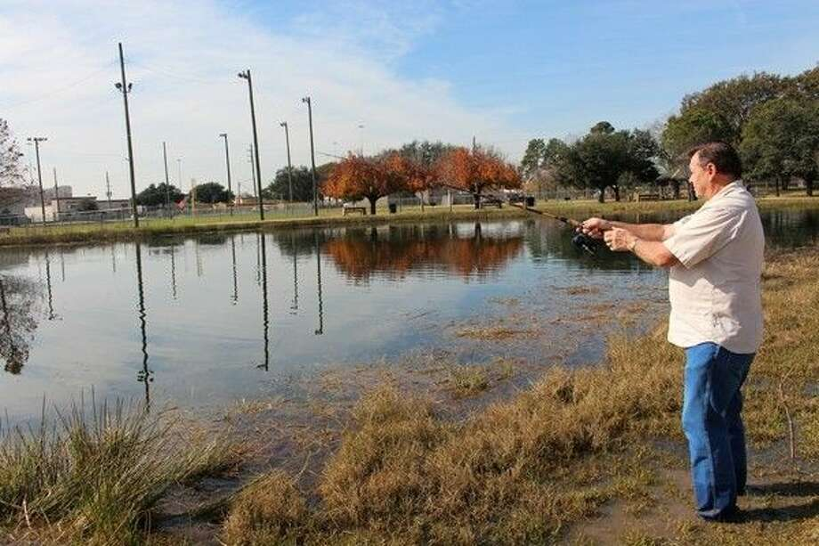 Danny Kabena fishes for rainbow trout at Bane Park soon after the lake is restocked.