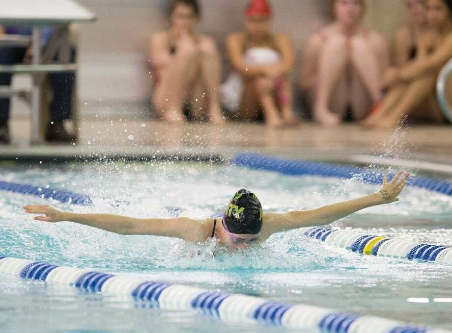 An Awty International swimmer competes in the 200 individual medley at Saturday's HAPPI meet at the Spring Branch ISD Natatorium. The Lady Rams won the Houston city private school championships and will now compete in the TAPPS East Regional Thursday in Conroe. Photo: Kevin B Long