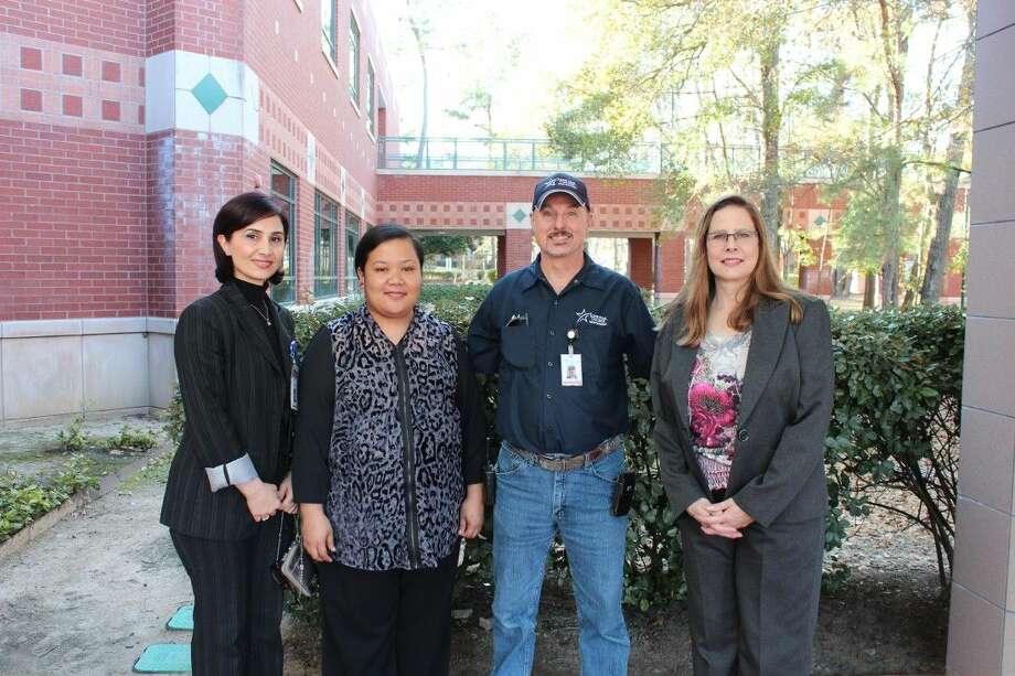 Four key staff members at Lone Star College-Montgomery were recently recognized with the annual Staff Excellence Award. Pictured from left to right are Michael Roberts, maintenance technician; Janis Bloecher, advisor; Cheri-Tee Ben, scheduling specialist; and Mozhgan Pourasadollah, learning center specialist. Photo: Submitted