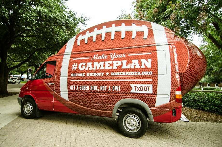 As part of its annual Football Impaired Driving Campaign, TxDOT toured the state in the Fan Van — a giant football on wheels — to encourage fans to have a game plan for a sober ride. Photo: Antoine Harris