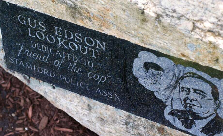 A plaque in a park on Weed Avenue is etched with the likenesses of cartoonist Gus Edson, who died in 1966, and two cartoon characters — Dondi, a World War II orphan who comes to live in the United States, and Andy Gump, chinless everyman and head of the Gump household  in Stamford, Conn. on Friday May 7, 2010. Photo: File Photo / Stamford Advocate File Photo