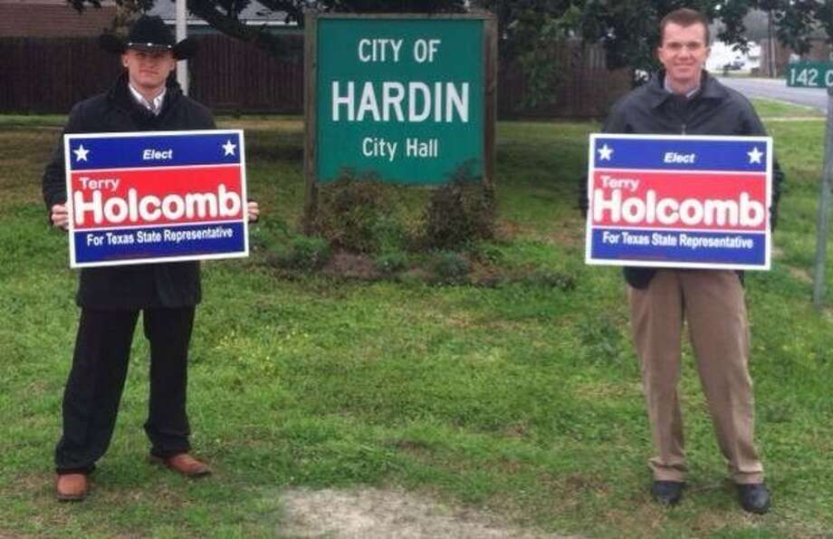 "On his campaign's Facebook page on March 4, Terry Holcomb Sr. (right) vowed to finish ""what [his son] was so proud of him for."" Photo: Facebook Photo"
