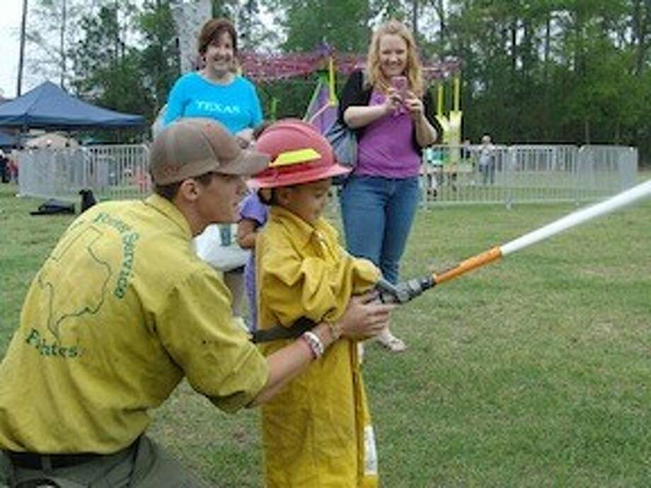 Firefighters volunteered at last year's Texas Wildlife and Woodland Expo and gave children an opportunity to hold the fire hose. The free event is scheduled for March 22 at the Lone Star College-Montgomery campus.