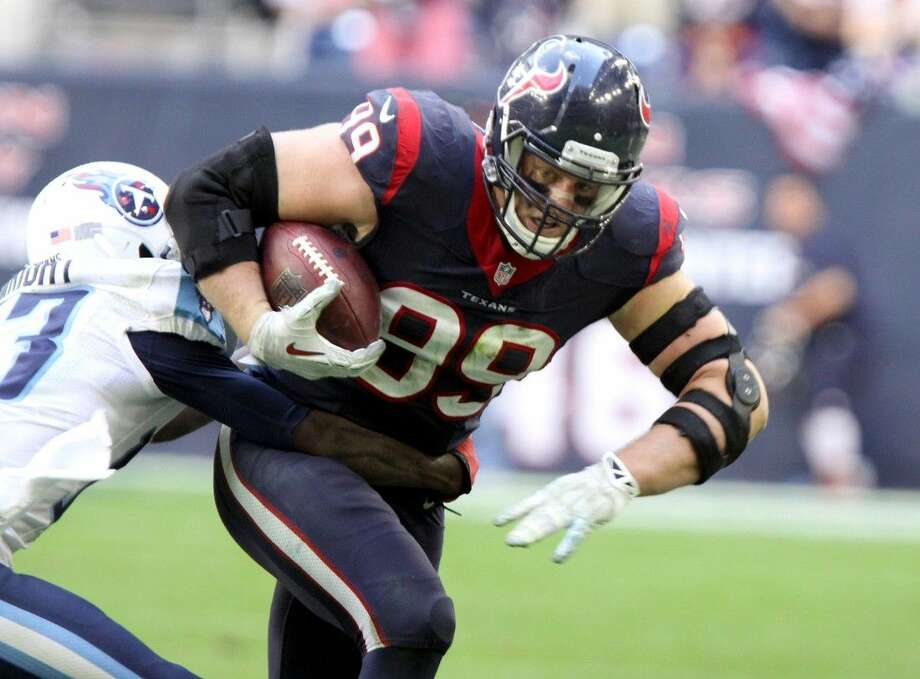 Houston Texans J. J. Watt runs back a fumble he caused against the Tennessee Titans during game at NRG Stadium in Houston, Texas on Sunday, November 30, 2014. Photo: Staff Photo By Alan Warren