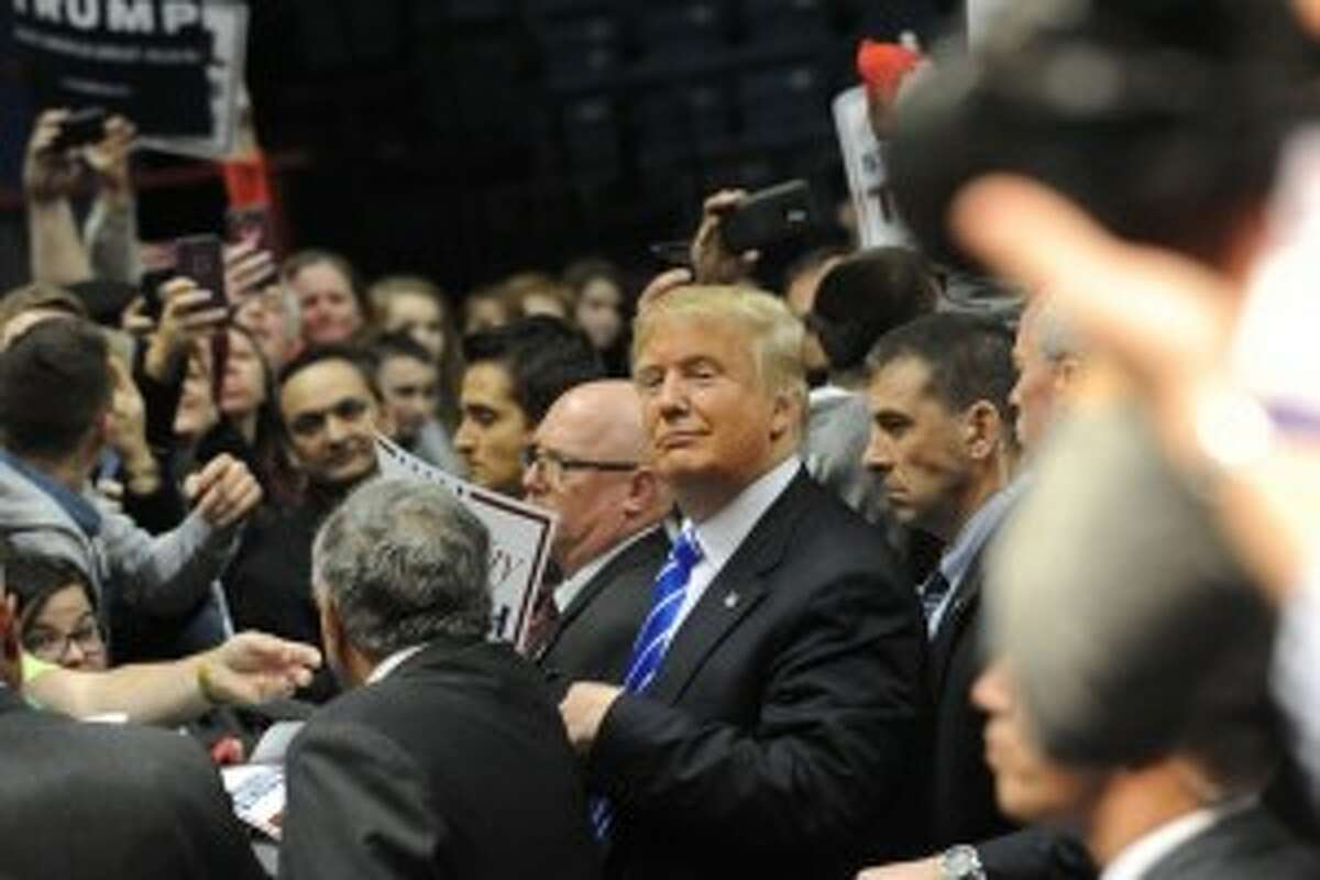 Then Republican presidential candidate Donald Trump interacts with the crowd at the end of a rally at the Times Union Center on Monday, April 11, 2016 in Albany, N.Y. (Lori Van Buren / Times Union)