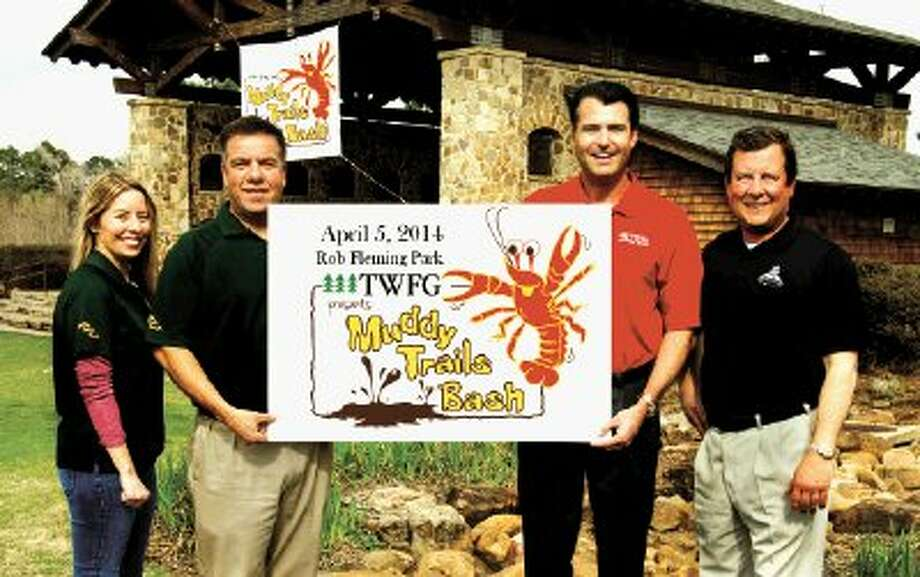 The Woodlands Township announces a three-year title sponsorship of the Muddy Trails Bash by The Woodlands Financial Group. Left to right: Angel Nicks and Chris Nunes of The Woodlands Township, Gordy Bunch, president and CEO of TWFG, and Nick Wolda of The Woodlands Township, display the new event logo as they prepare for the 2014 TWFG Muddy Trails Bash at Rob Fleming Park in The Woodlands. / The Woodlands Township