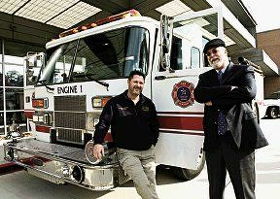 LSC-Kingwood's fire science program unveiled its new firetruck during in-service. Proudly displaying the vehicle are Jason DeVries, director and fire science professor, and Jim Stubbs, dean of the Fire Science, Letters, Art and Kinesiology (FLAK) Department.