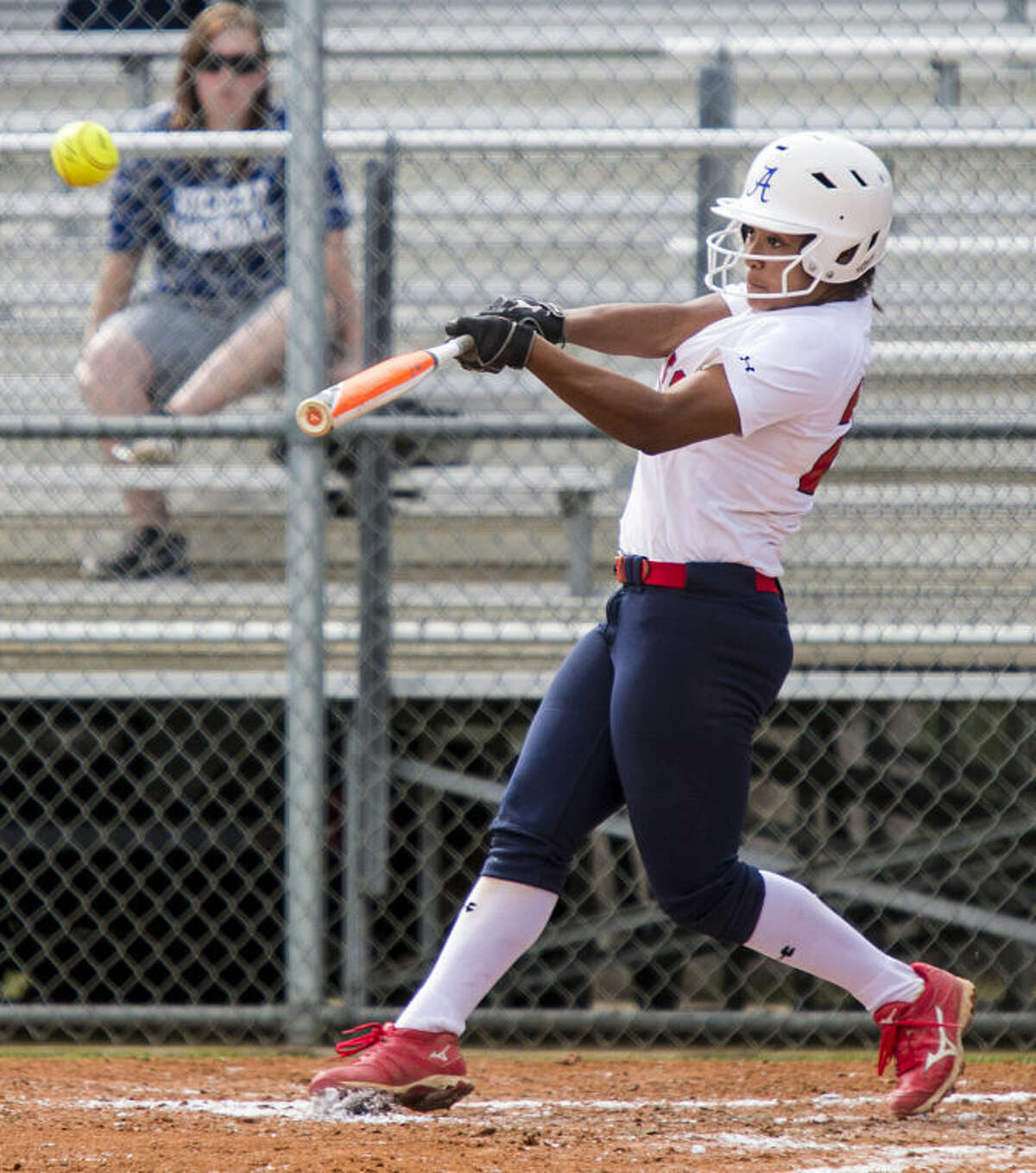 Atascocita's Kaitlyn Washington hits bringing in three baserunners during Atascocita's victory over Dekaney on March 11, 2014, at Atascocita High School. (Photo by ANDREW BUCKLEY/The Observer)