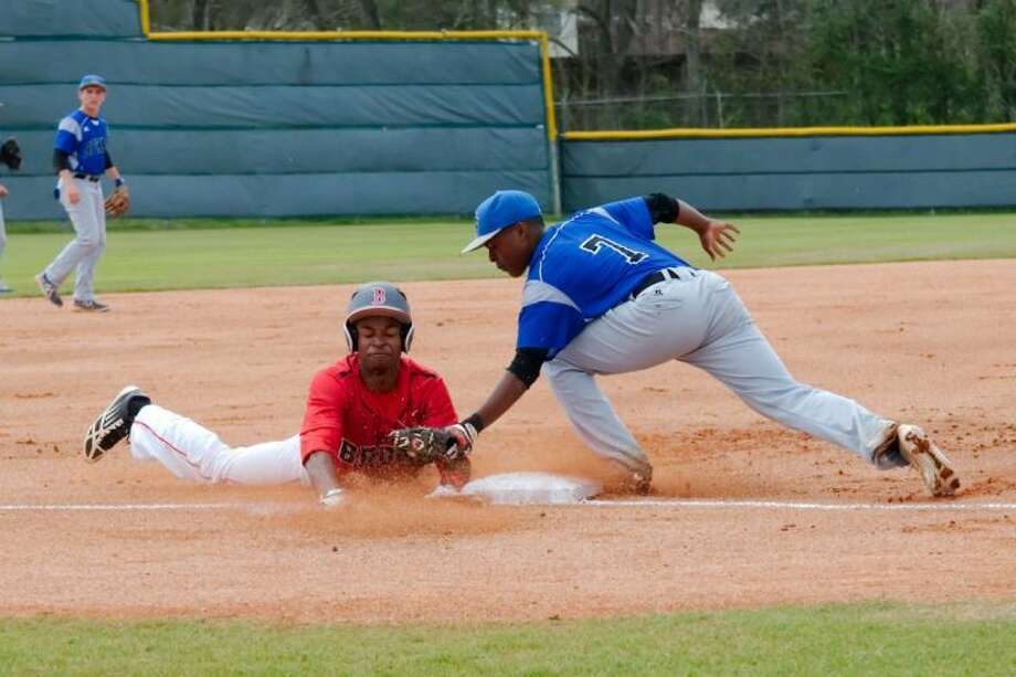 Clear Springs' Tyrone Thomas (7) makes the tag on Clear Brook's Corey Julks (8) as he tries to stretch a double into a triple. Julks drove in two runs on the play. Photo: KIRK SIDES