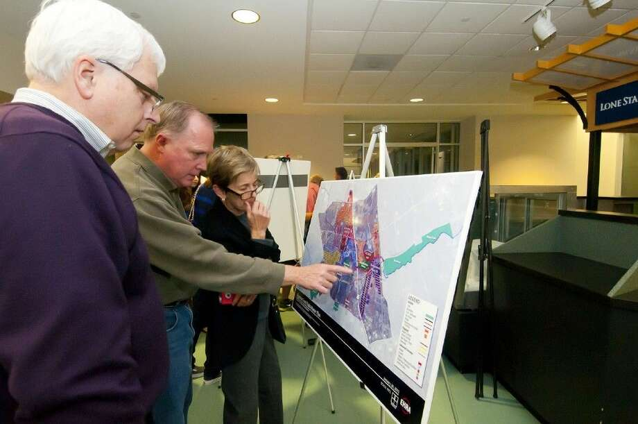 Bernie Luksich, John Haynes and Colleen Haynes, view Cypress Creek Trail study maps. The project aims to be finalized by February 2015.