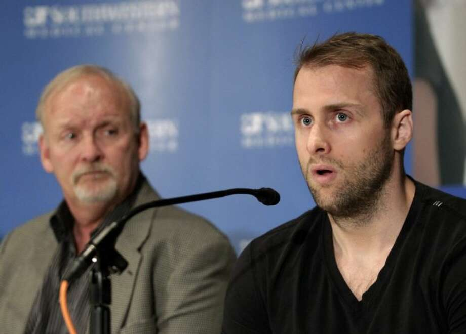 Dallas Stars forward Rich Peverley, right, speaks during a news conference at the University of Texas Southwestern Medical Center on Wednesday in Dallas. Peverley will not play again this season. Also pictured is Stars coach Lindy Ruff.