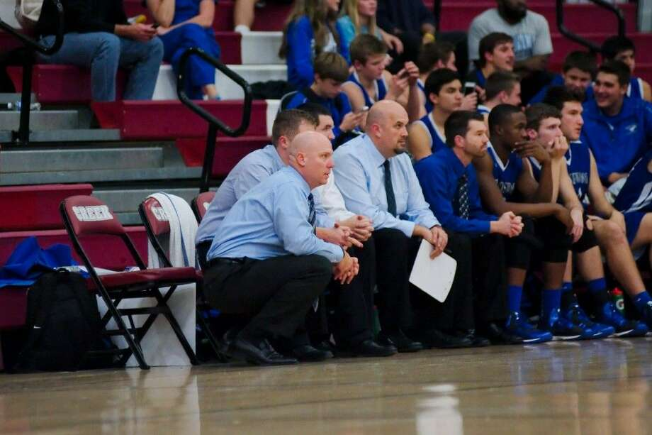 Friendswood head basketball coach Jeff Keener (foreground) knows that intestinal fortitude will be a key if the Mustangs are to make the playoffs in District 24-6A. Photo: KIRK SIDES