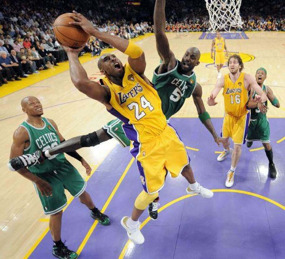 Lakers guard Kobe Bryant (24) will sit out the rest of the 2014 season. / Pool AP