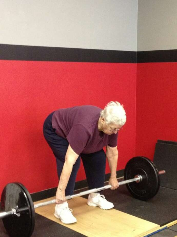 Jean McLeod, 81, got the idea to start lifting weights after admiring how much stronger her grand-daughter (a former Kingwood High School swimmer) had gotten after working with Baker during her high school athletic career.
