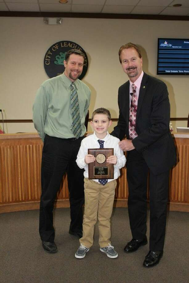 Seven-year old Keegan Spatz, a star on the court, was recognized at last week's League City council meeting for his sportsmanship on and off the basketball court.