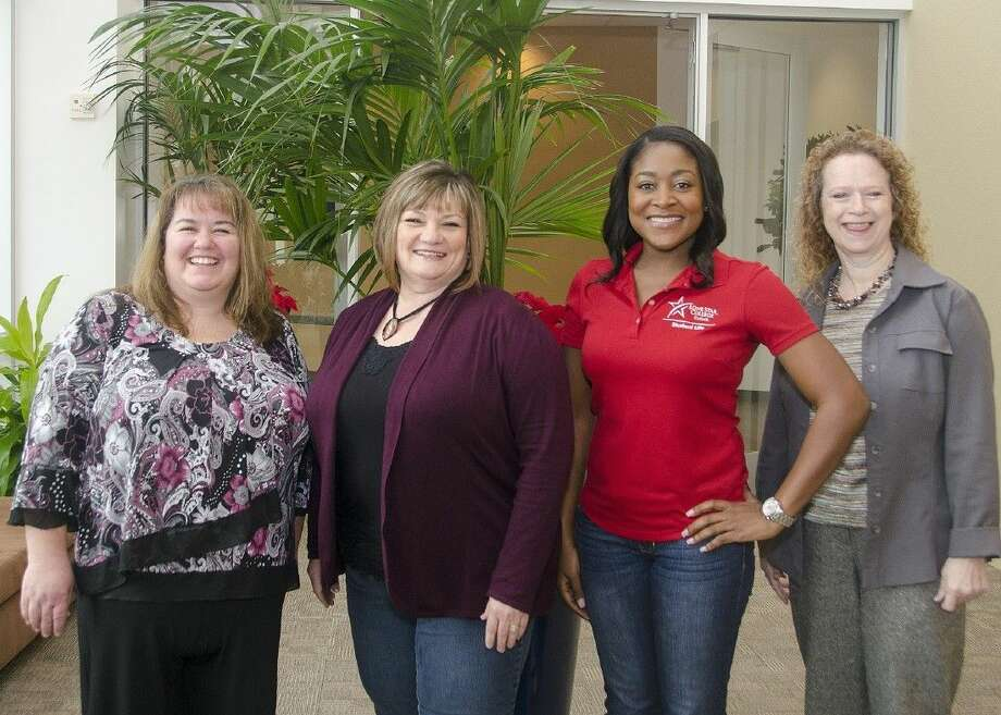 The Lone Star College-CyFair's Staff Excellence Award winners, from left, Debbie Seidel, Rhonda Holstien, Tashemia Jones and Chris Longoria, will be recognized this spring for their outstanding contributions to the college and vision of excellence. Photo: Submitted Photo
