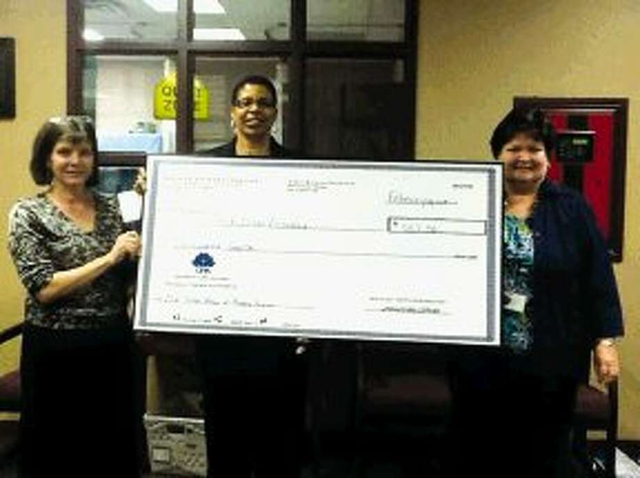 Pictured from left to right are academic lead teacher Melinda Butler, Houston CPA Society board member Gail Neely and principal Karen Weeks.