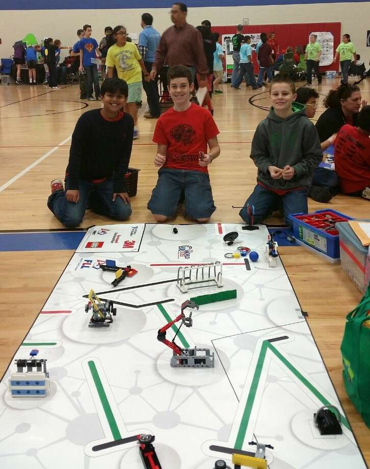 Hamilton Middle School sixth-grade student Weston Coleman, pictured on the right, competes in the South Texas First Lego League Championship on Dec. 13 with his team, Bricksmart. The team won the Champion's Award to advance to the World FLL Championships in St. Louis, Mo., in April. Photo: Submitted Photo