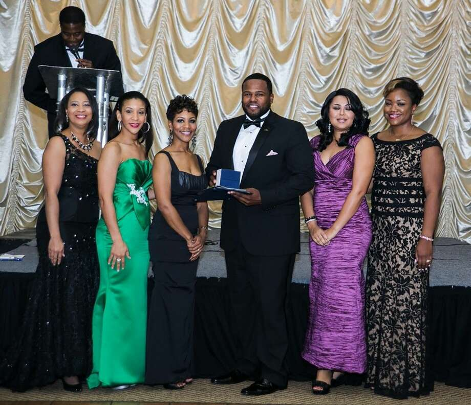 Cypress Lakes High School teacher and coach Brian Roberson is honored by the Ivy League Educational and Charities Foundation at the Educators' Ball in November. Pictured (L-R) are Chamelia Robinson, event chair; Shalonda Jones, ILECF vide president; Brandi Woods, ILECF president; Brian Roberson, Cypress Lakes educator; Tracie Neuls, event co-chair; and Charlene Wade, honoree committee chair. Photo: Tomayia Colvin