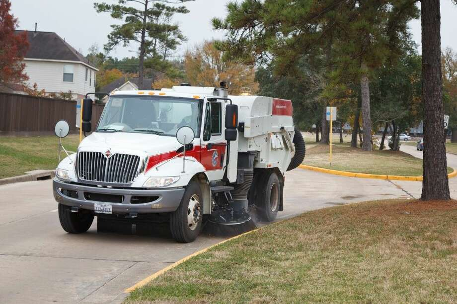 A street sweeper clears debris from a Precinct 4 roadway. Photo: Submitted Photo