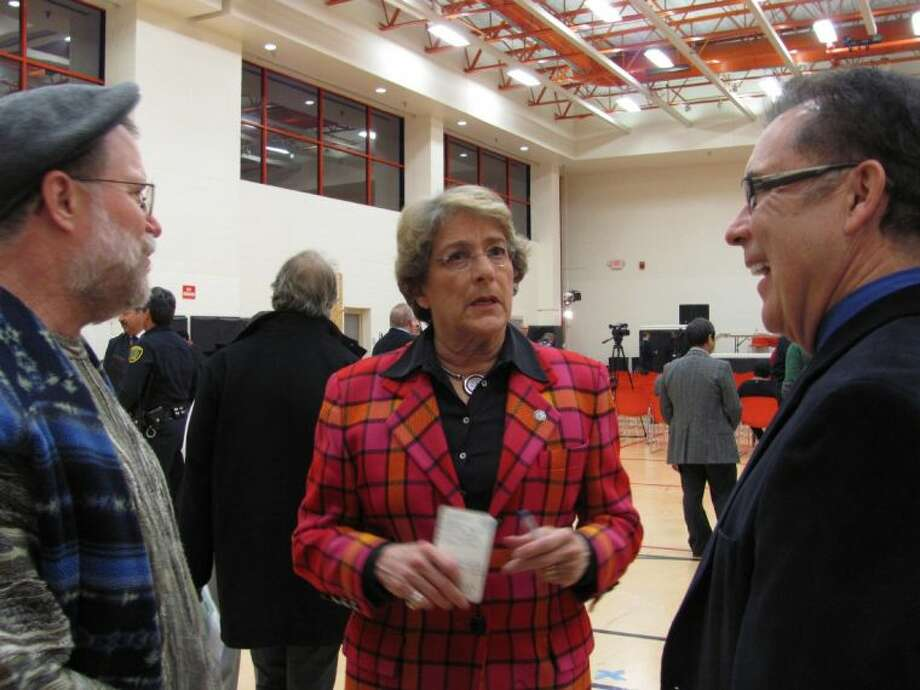 District C City Council Member Ellen Cohen talks with C. Dean Lovett, left, and Randy Mitchmore, who were among more than 150 to attend a Capital Improvement Plan meeting held March 5.