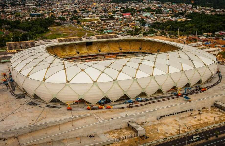 This photo released by Portal da Copa shows Arena da Amazonia on Sunday, the day of its inauguration in Manaus in the state of Amazonas, Brazil. Three World Cup stadiums still have to be finished, including the one hosting the opener in Sao Paulo in about three months.