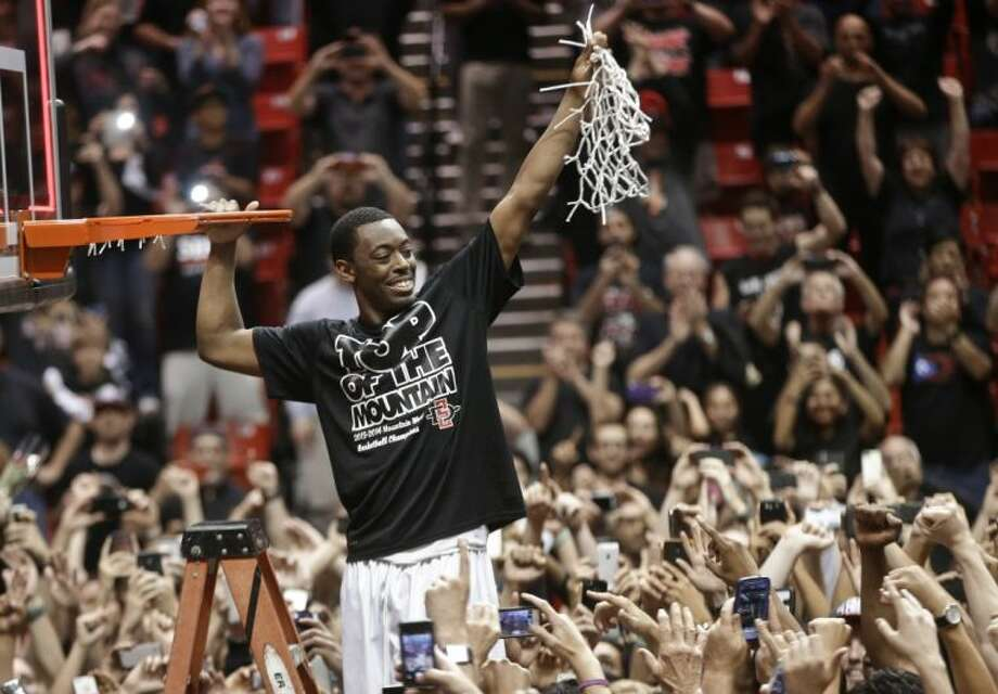 San Diego State's Xavier Thames celebrates after San Diego State defeated New Mexico 51-48 to win the Mountain West Conference title on Saturday in San Diego.