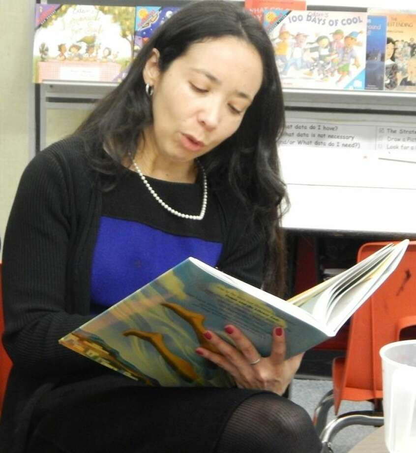 Shown reading to students at Briargate Elementary is Dr. Xochitl Rodriguez, FBISD assistant superintendent. Photo: Photo Courtesy FBISD