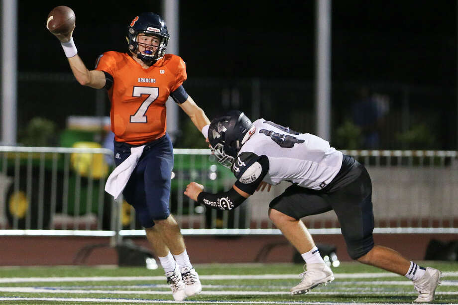 Brandeis quarterback Mason Corbett tries to escape from Boerne Champion's Judd Oefinger in his end zone during the first half of a game at Farris Stadium on Sept. 9, 2016. Photo: Marvin Pfeiffer /San Antonio Express-News / Express-News 2016
