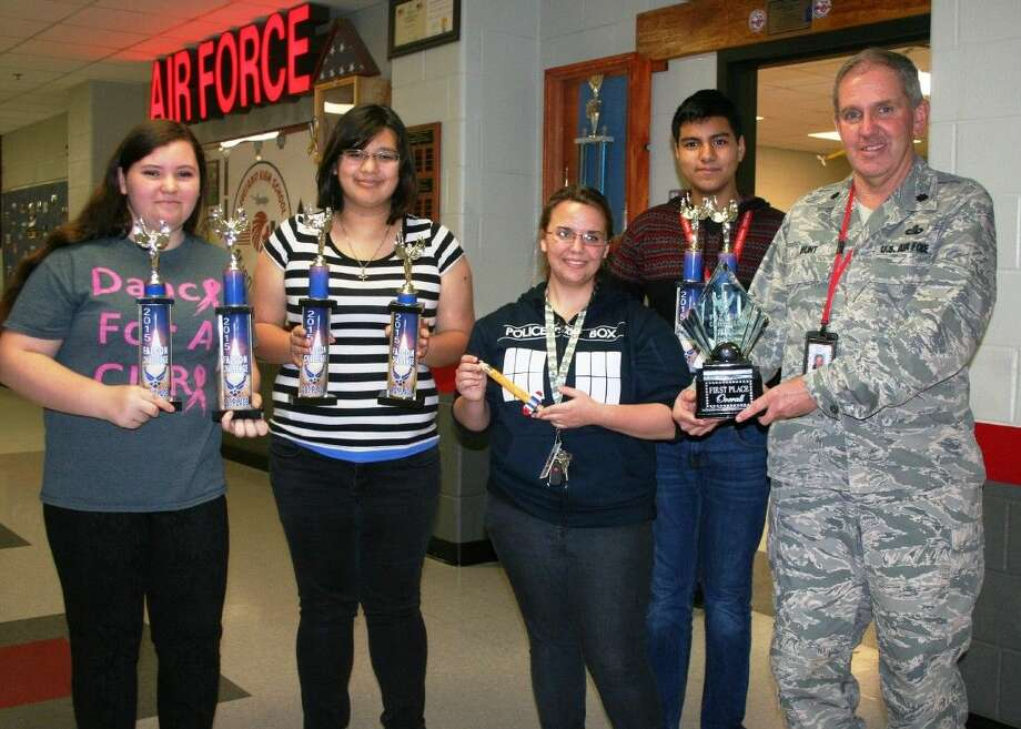 Cleveland High School AFJROTC members, including Brittany Winn, Cristian Roldan and Cynthia Valadez, worked together under Col. Robert Hunt, to create a rocket inspired by the recent attacks of the Charlie Hebdo offices in Paris. Photo: Stephanie Buckner