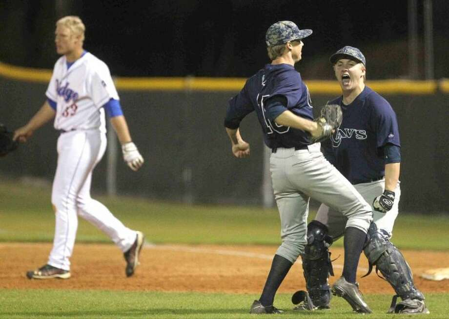 College Park players celebrates as Oak Ridge's Luken Baker walks off the field after hitting a fly ball to end Thursday's District 14-5A game. To view or purchase this photo and others like it, visit HCNpics.com.