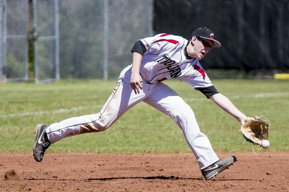 Coldspring's Brock Barbay attempts to field the ball during Coldspring's 10-2 victory over Cleveland on March 13, 2014, at Coldspring-Oakhurst High School. Photo: ANDREW BUCKLEY